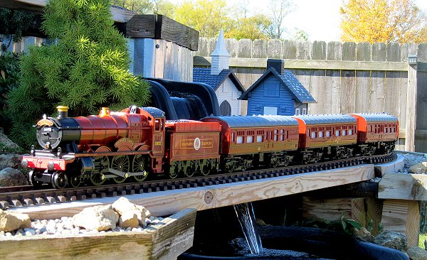 The Hogwarts Express is the hardest of these trains to find; it was only made for a short time.  This photo shows one with a car borrowed from another set running on the NEW New Boston and Donnels Creek railroad before a cold-weather open railroad. Click for bigger photo.